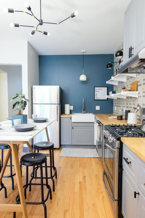 grey ikea kitchen cabinets with blue wall