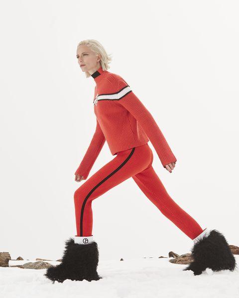 Standing, Red, Leg, Sportswear, Thigh, Tights, Footwear, Human leg, Trousers, Balance,