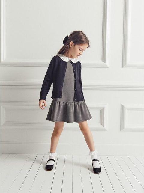 Clothing, Uniform, Outerwear, Fashion, School uniform, Dress, Footwear, Sleeve, Child, Leg,