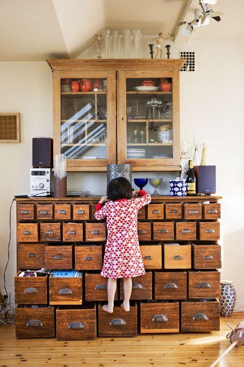 girl climbing drawer