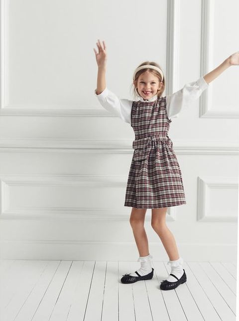 White, Clothing, Standing, Child, Pattern, Design, Plaid, Floor, Footwear, Photography,