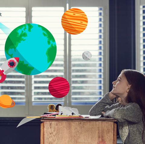 Girl dreaming about space and planets