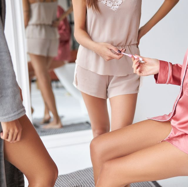 girl giving tampon to her friend