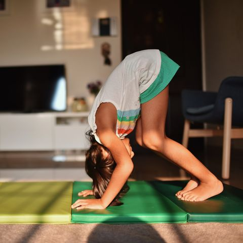 girl practising somersault at home