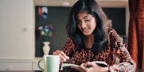 Girl reading book with a coffe mug