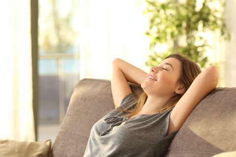 Girl relaxing on a sofa at home