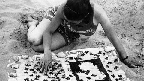 Puzzel op het strand