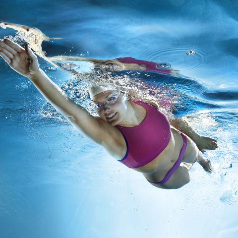 girl swimming, underwater view