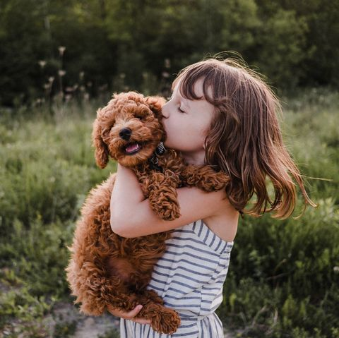 Girl with dog outside playing