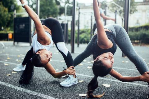 Girlfriends doing stretching before fitness training.