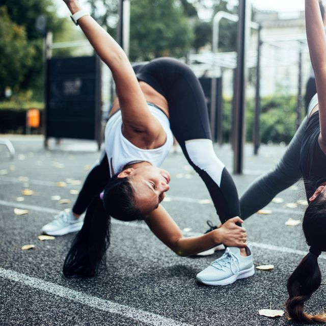girlfriends doing stretching before fitness training