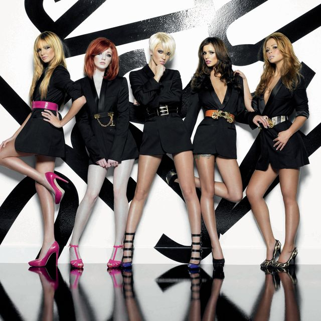 girls aloud in stylish black outfits posing against a black and white background for an out of control promo shot