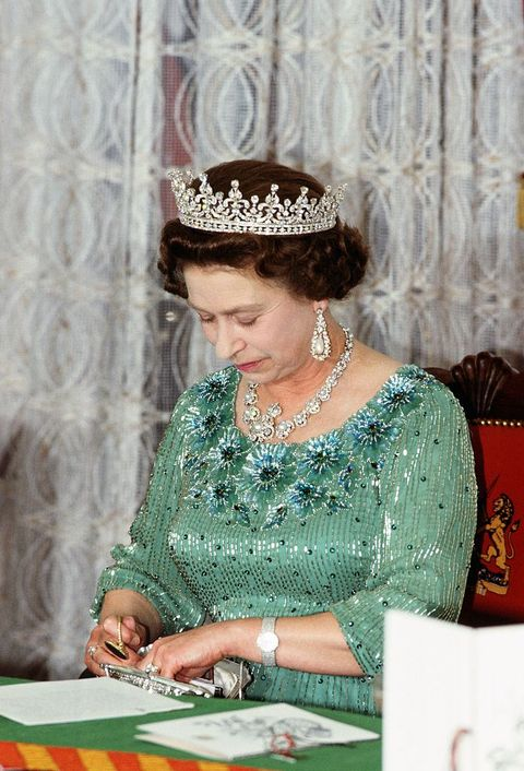 kenya   january 01  queen elizabeth ii looks through her handbag during a banquet in kenya  photo by tim graham photo library via getty images