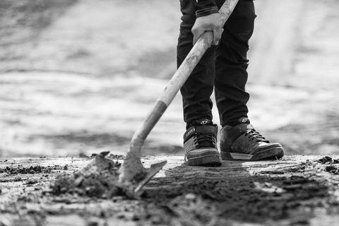 Black-and-white, Tree, Monochrome photography, Shovel, Leg, Footwear, Soil, Human leg, Photography, Monochrome,