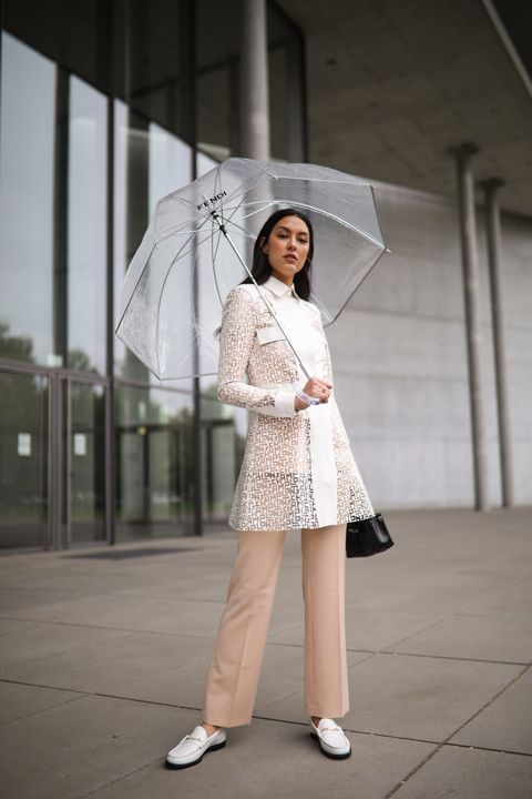 munich, germany   may 13 rebecca mir wearing drykorn suit, longchamp rain coat and bag and jimmy choo loafer on may 13, 2020 in munich, germany photo by jeremy moellergetty images
