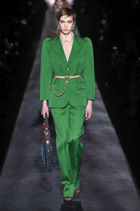 Fashion model, Runway, Fashion, Fashion show, Clothing, Green, Pantsuit, Human, Suit, Outerwear,