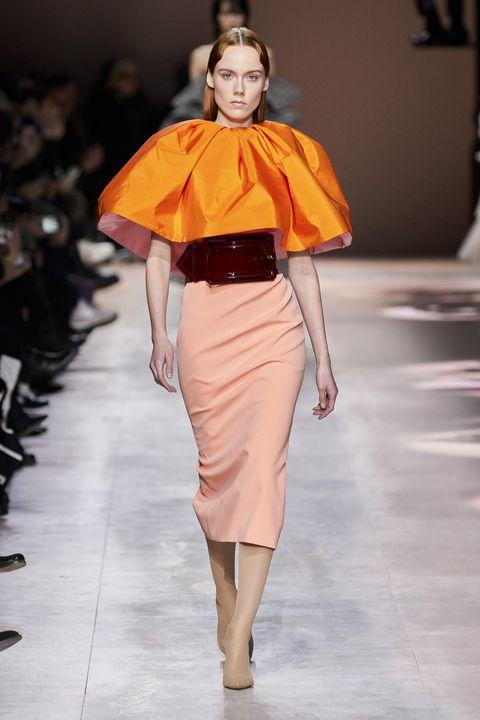 Fashion show, Fashion, Fashion model, Runway, Clothing, Orange, Yellow, Shoulder, Haute couture, Fashion design,