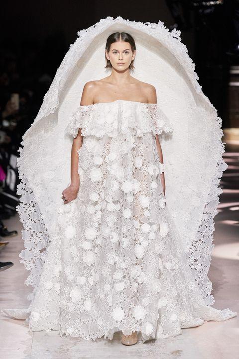 Wedding dress, Fashion model, Dress, Gown, Fashion, Clothing, Haute couture, Shoulder, Bridal clothing, Bridal accessory,