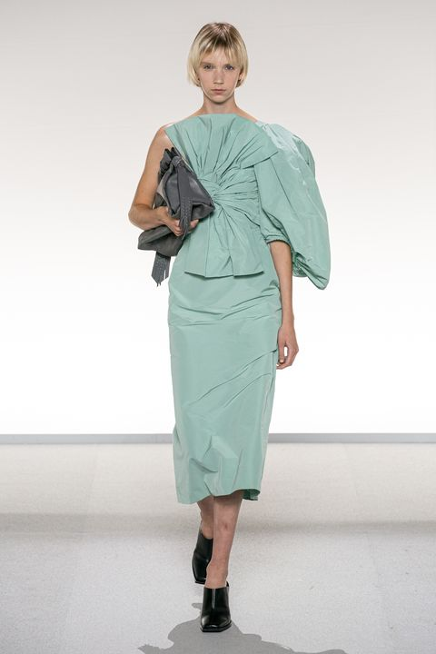 Fashion model, Fashion show, Fashion, Clothing, Runway, Shoulder, Fashion design, Dress, Standing, Joint,