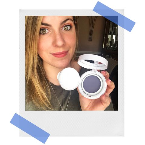woman wearing makeup and holdingGLAMGLOW SUPERMATTIFY Clarifying Oil-Control Face Primer