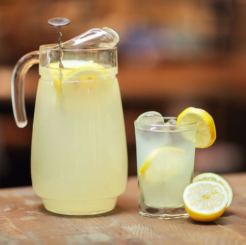 Glass jar and glass with fresh lemonade