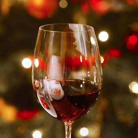 Glass of red wine at Christmas time, close-up