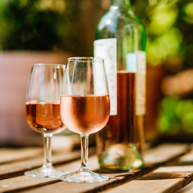 glass of wine on a table in sunlight