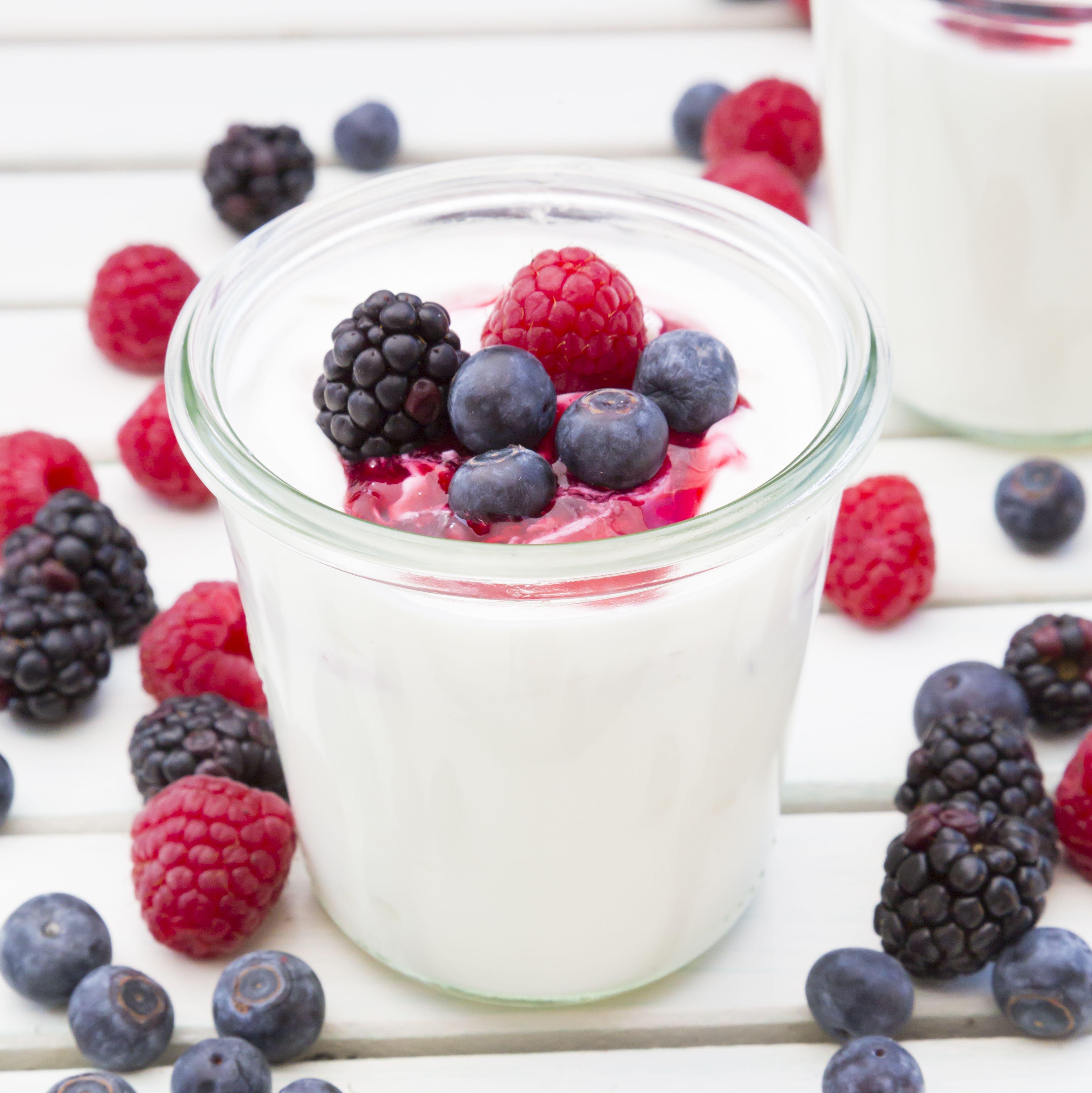 Glasses of Greek yogurt with berries