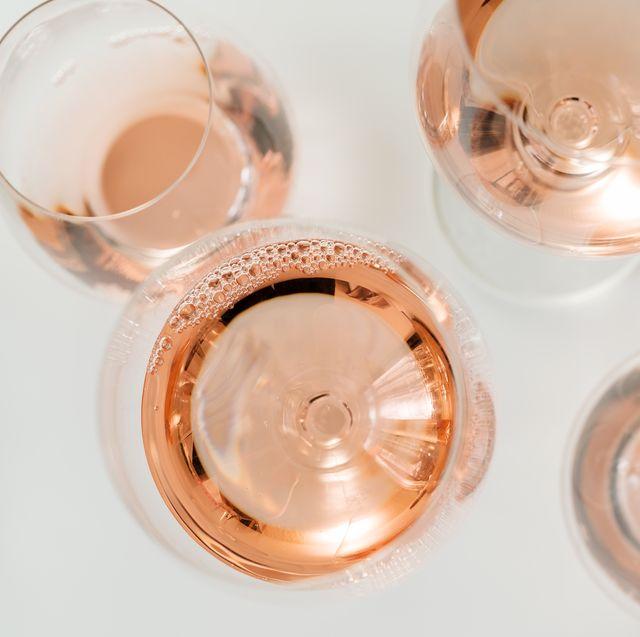 glasses of rose wine on white background