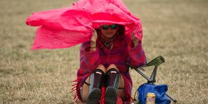 Sheltering from rain at a festival