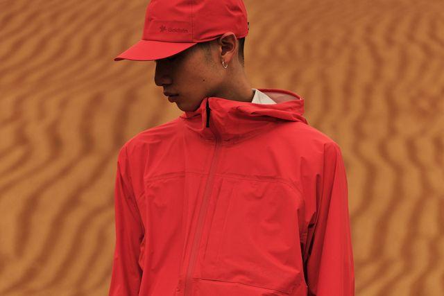 man wearing goldwin red jacket