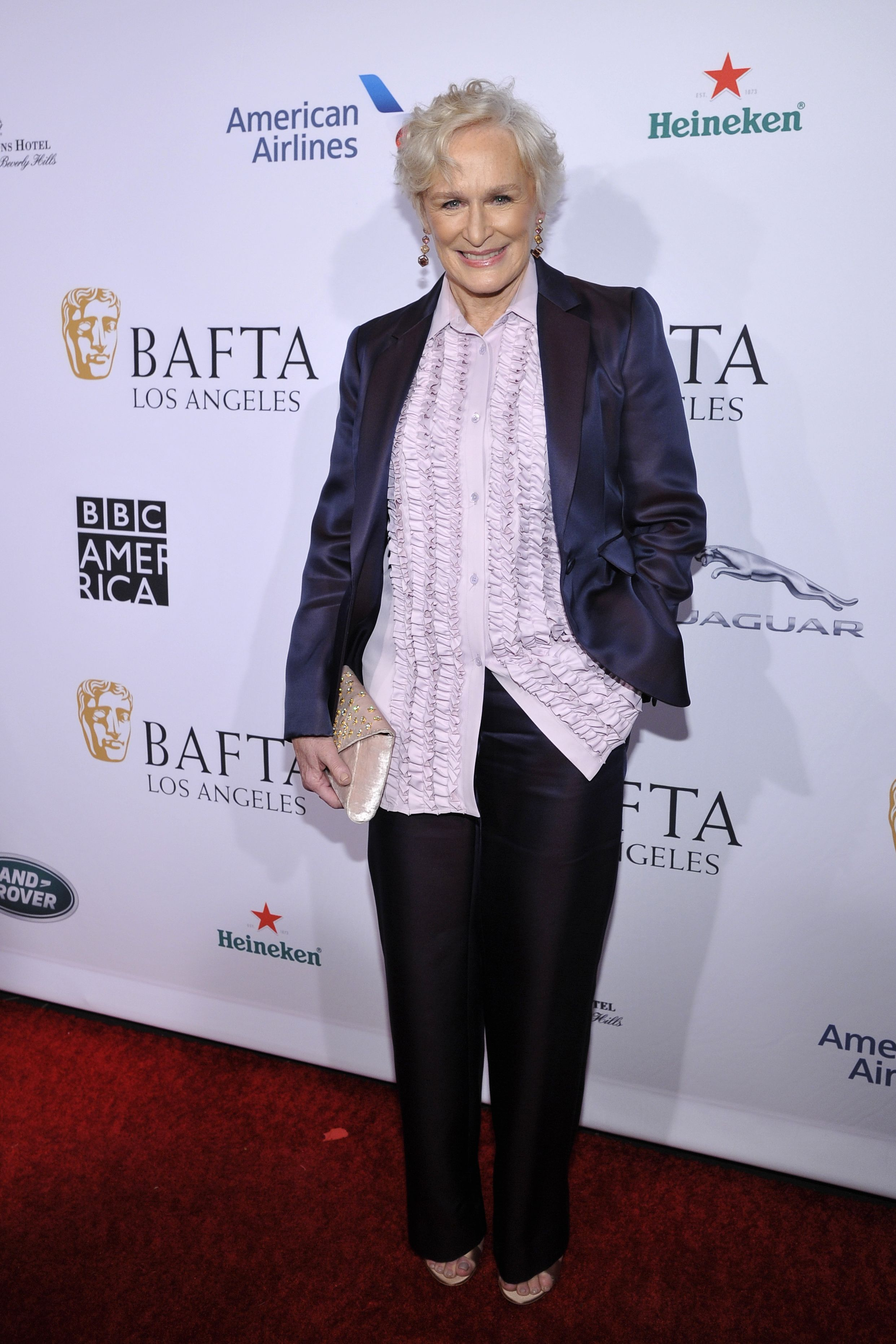 The Wife star paired a lavender ruffled blouse with a deep violet suit by Sies Marjan for the BAFTA Los Angeles Tea Party. The actress complimented her look with a gold clutch and colorful drop earrings.
