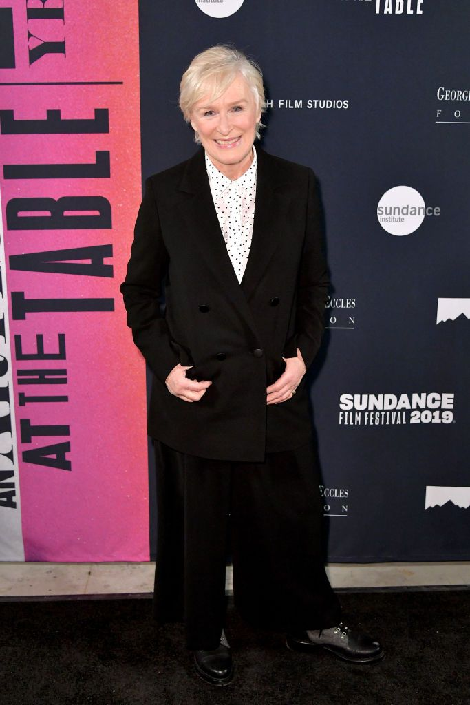 Close wore black trousers and a deep v-neck coat with a polka dot blouse to the Sundance Film Festival.
