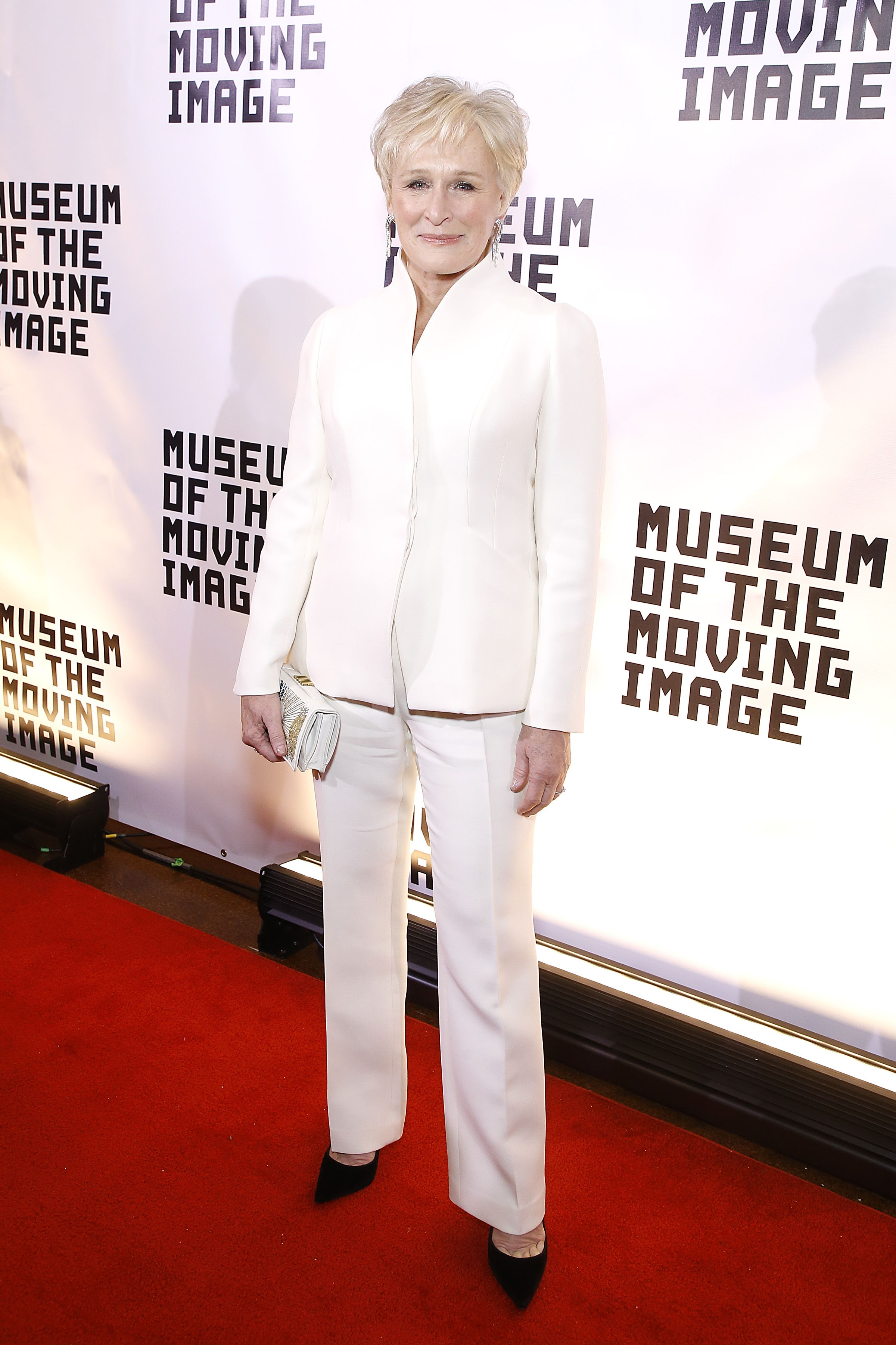 Close chose an elegant white suit for an event in her honor by the Museum of the Moving Image in New York City. She paired the look with diamond statement earrings and black pumps.