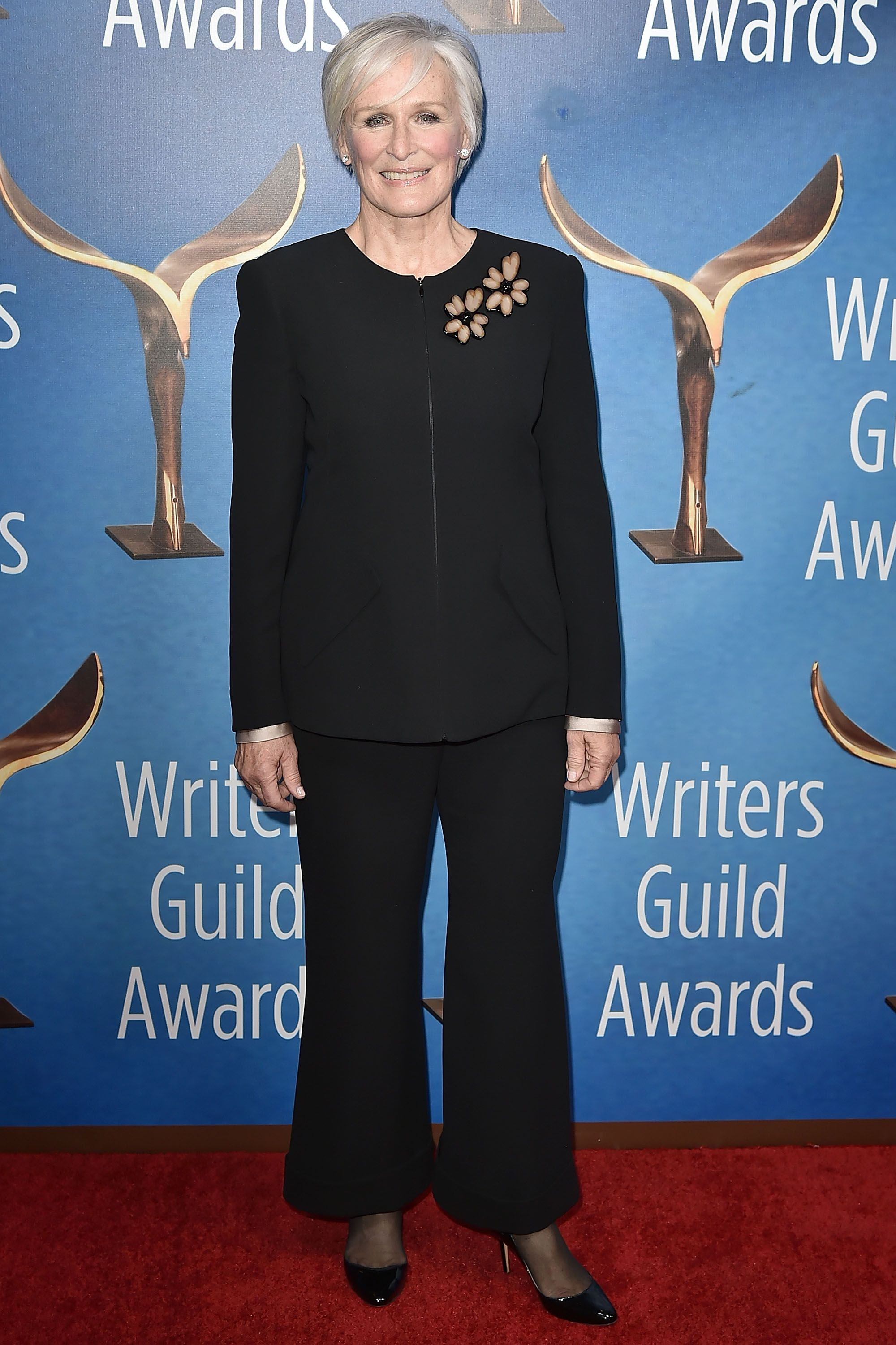 Close looked elegant in a black zip-up jacket with two embroidered flowers at the 2018 Writers Guild Awards in Los Angeles.