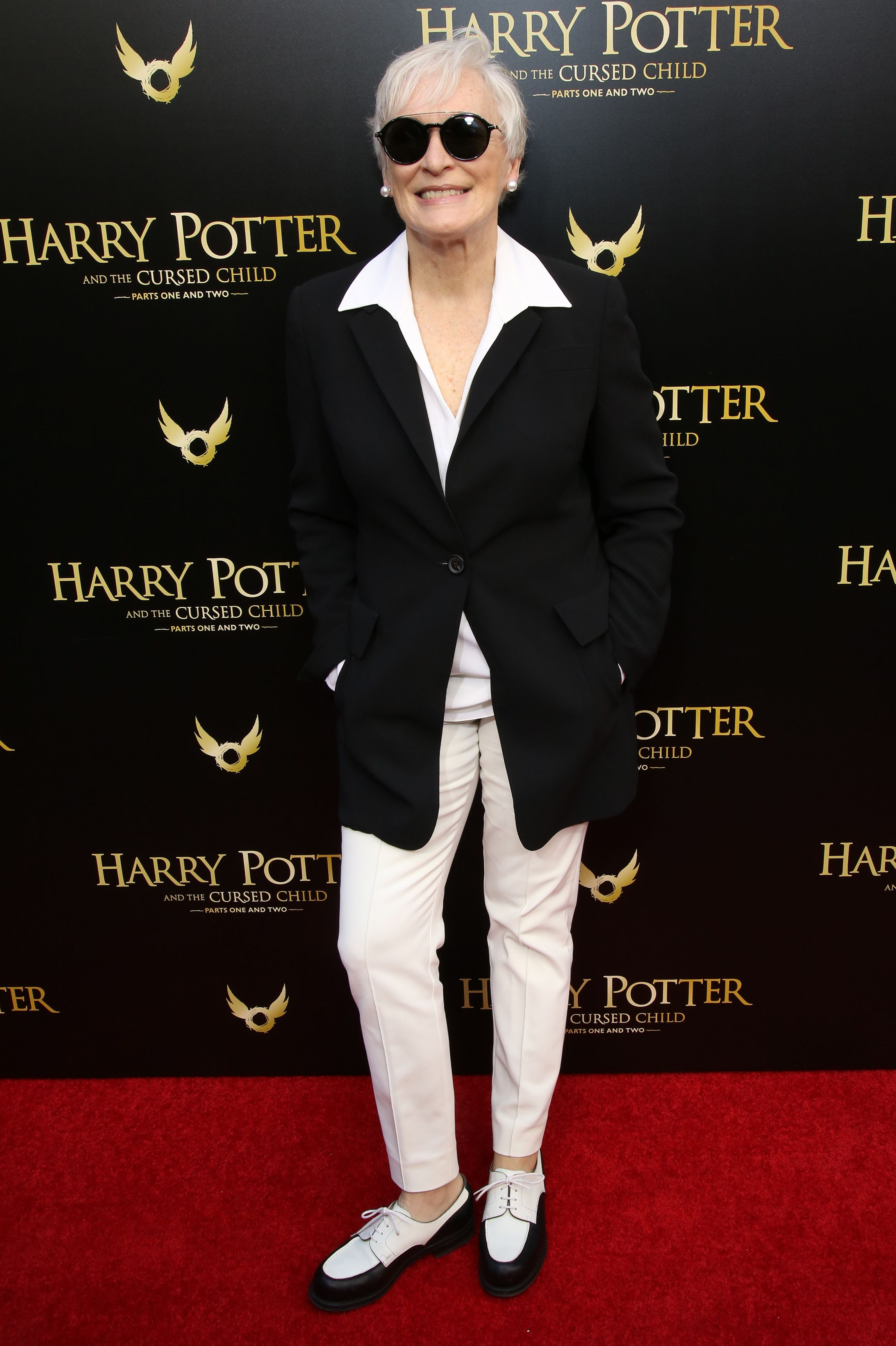 Close pulled together an effortlessly cool look of white trousers, a collared shirt, an oversized blazer, oxford shoes, and rounded sunglasses for Broadway's opening performance of Harry Potter and the Cursed Child Parts One and Two.