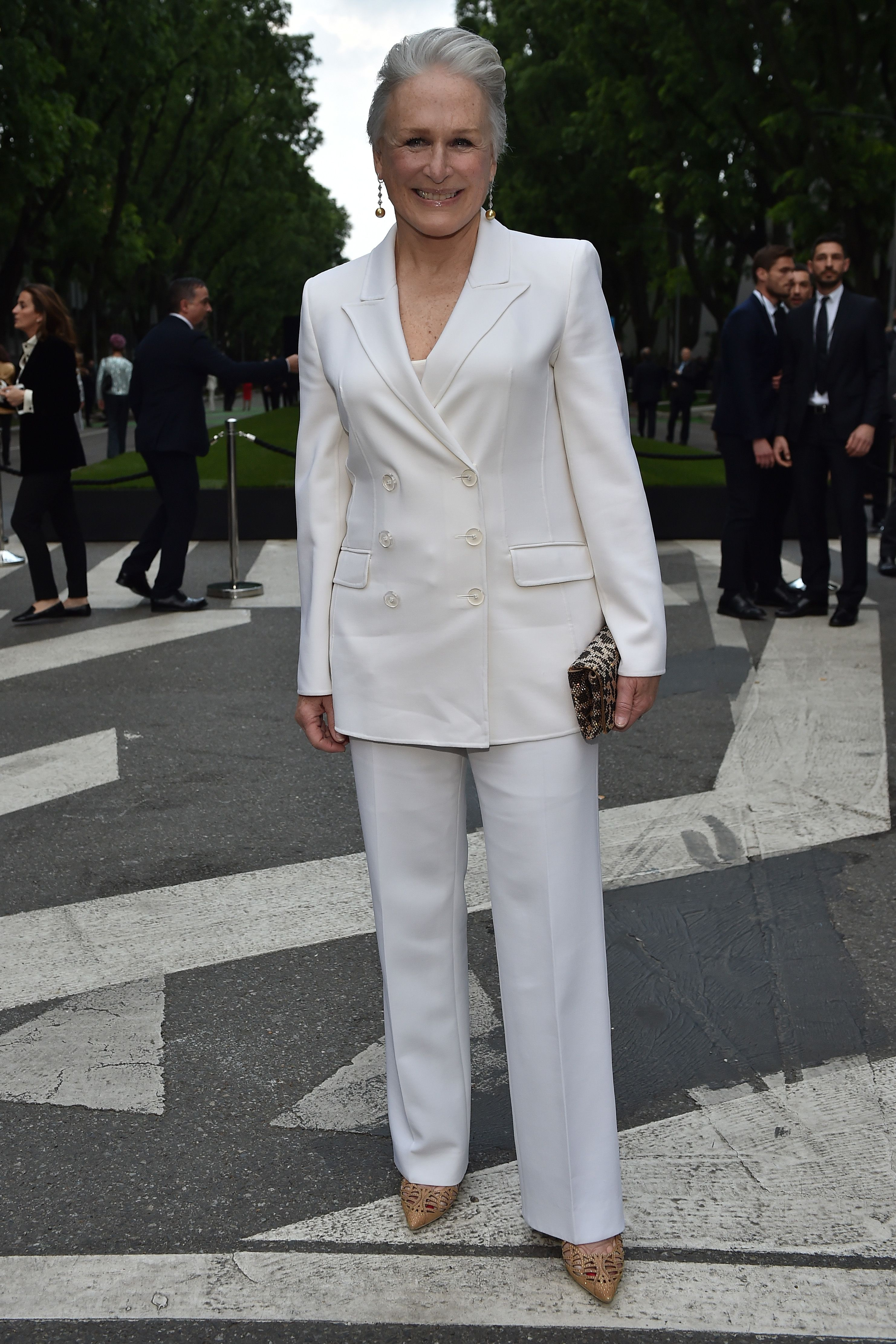 The actress accessorized her Armani white suit with an animal-print clutch, tan pumps, and gold drop earrings at Giorgio Armani's 40th anniversary event.