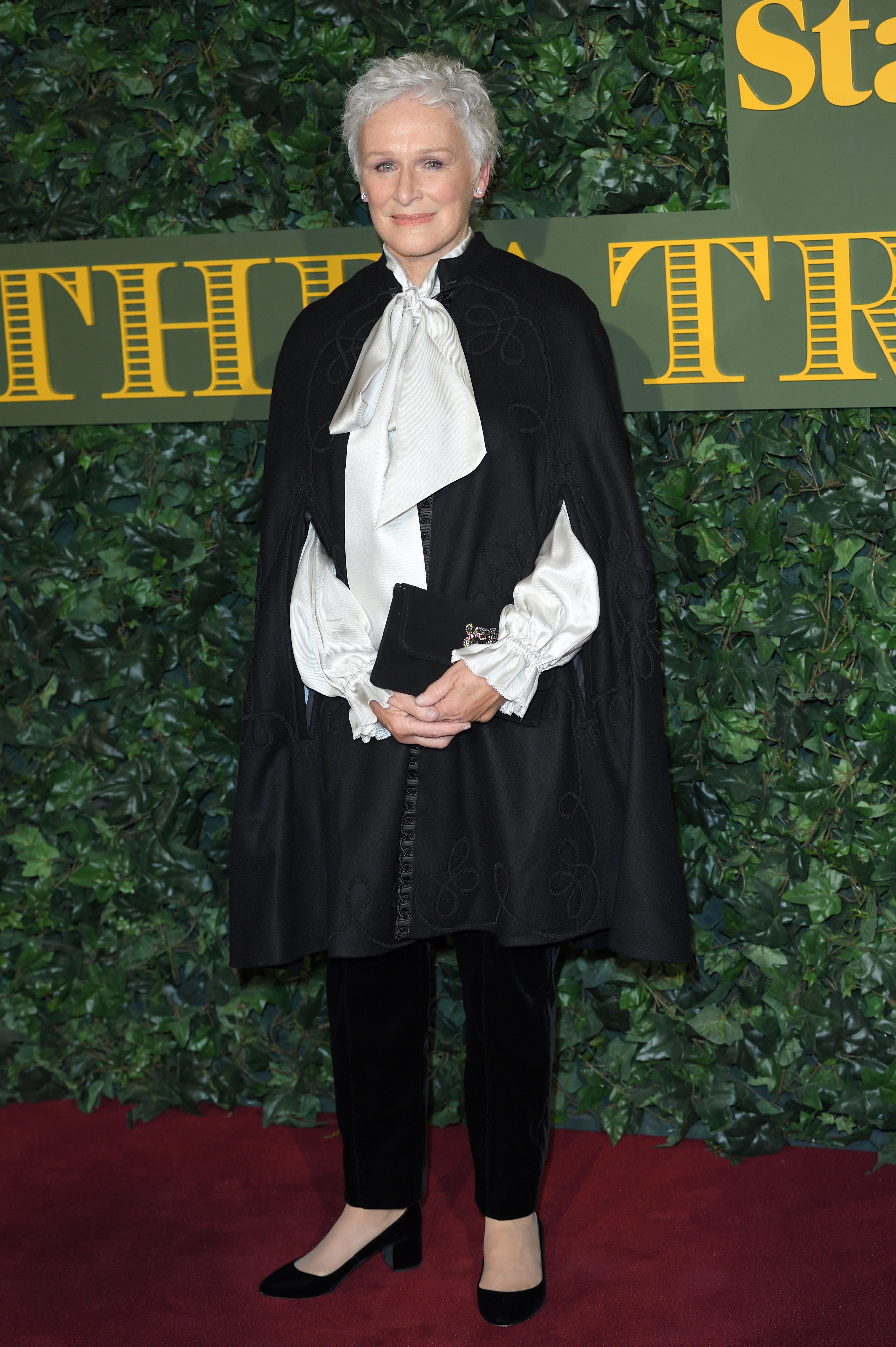 Glenn Close arrived at the London Evening Standard Theatre Awards wearing a sophisticated cape over a white silk pussy-bow blouse and trousers.