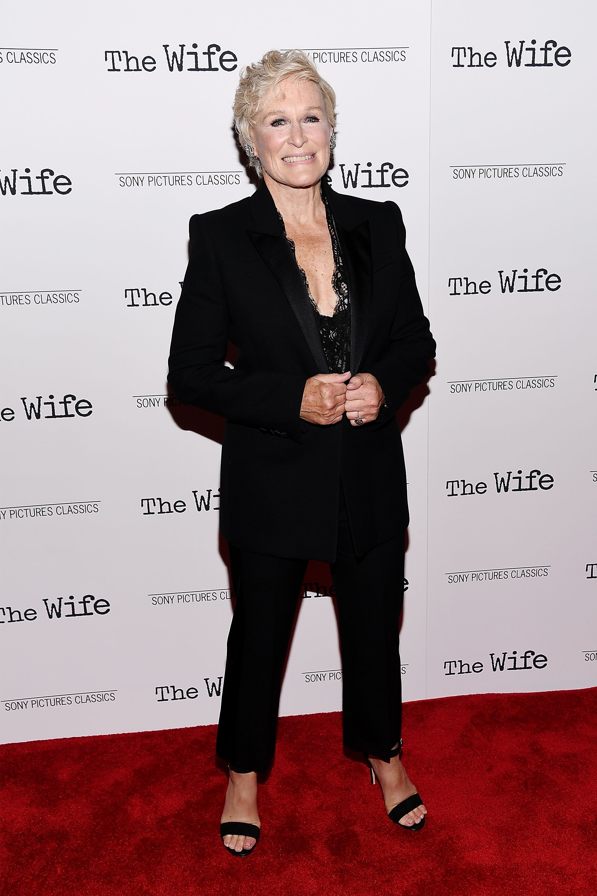 For a screening of The Wife at the Paley Center for Media , Glenn Close paired a tailored black suit with a low cut lace top and black sandal heels.