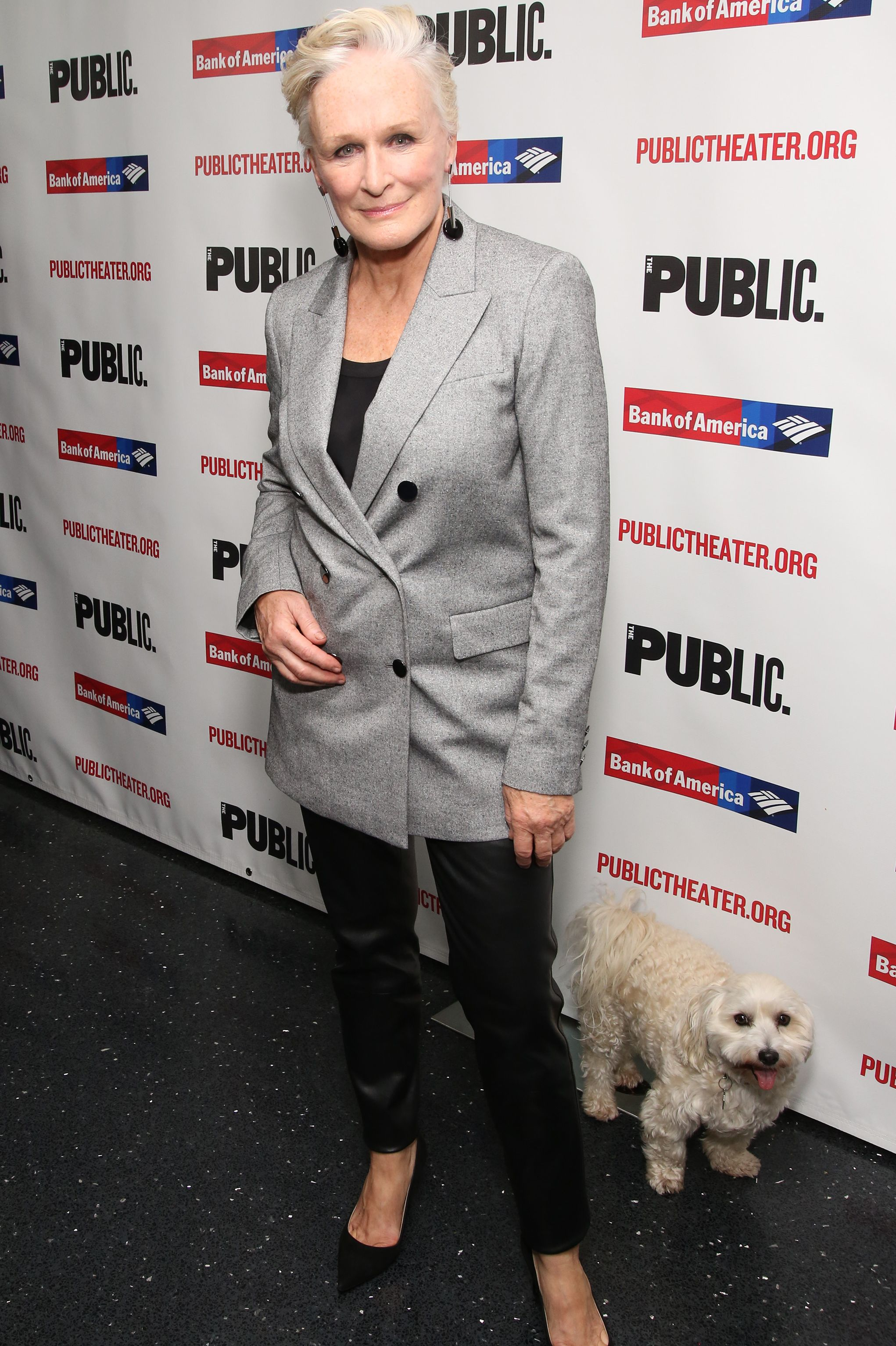 "Glenn Close wore a gray oversized blazer and black leather pants, black statement earrings and pumps to opening night of ""Mother of the Maid."" Naturally, her dog, Pip, was in attendance as well."
