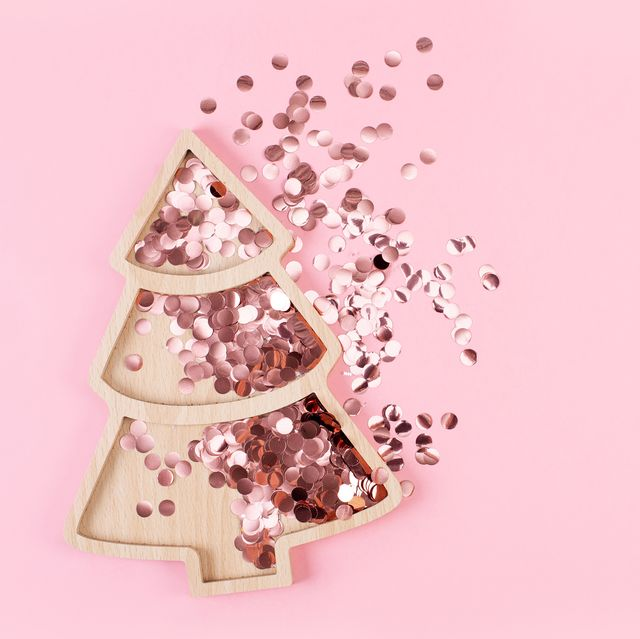 christmas tree shape with sparkles inside it on pink pastel background flat lay style christmas mood