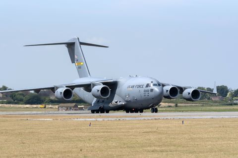A USAF C-17A Globemaster strategic transport aircraft taxing along a runway at RNAS Yeovilton, Somerset, England, UK, The jet will form in the static display on Saturdays airshow at the base