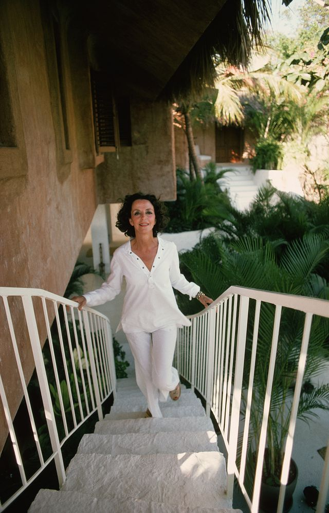 february 1975  gloria guinness climbing a staircase in acapulco, mexico, where she owns a luxury beach house  photo by slim aaronsgetty images
