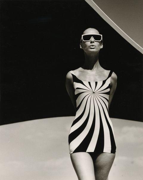 Fashion model, Eyewear, Fashion, Clothing, One-piece swimsuit, Black-and-white, Model, Beauty, Fashion design, Sunglasses,