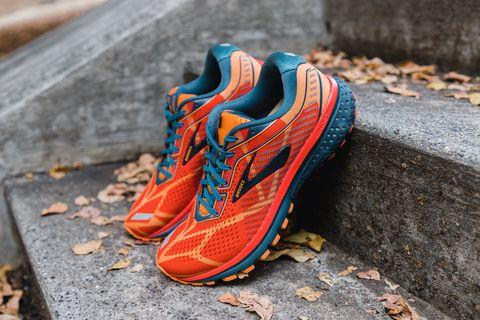 Footwear, Orange, Shoe, Blue, Athletic shoe, Grass, Tree, Sneakers, Outdoor shoe, Pattern,