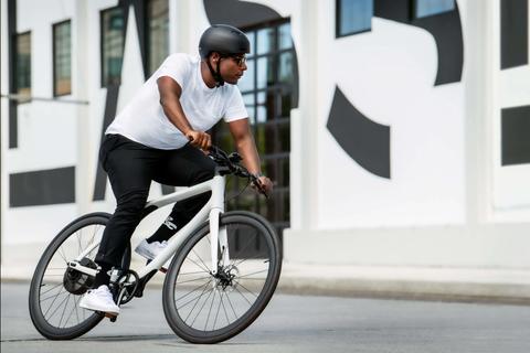 a man riding a white bike