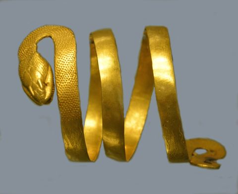 Gold bracelet in the shape of a snake.