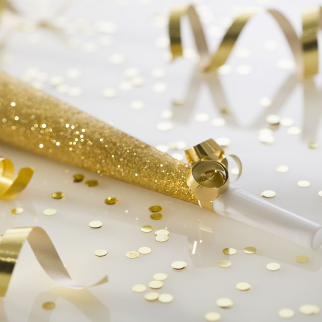 gold party horn and confetti