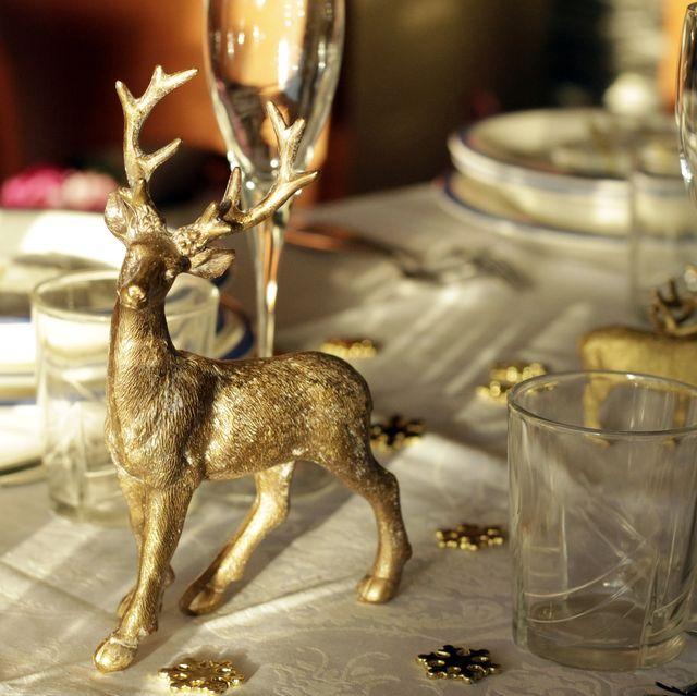 golden reindeer decorating festive christmas table