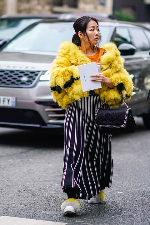 Street fashion, Yellow, Fur, Clothing, Fashion, Footwear, Snapshot, Fur clothing, Textile, Outerwear,